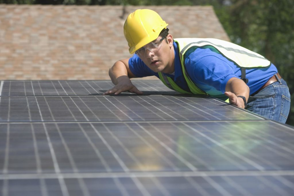 professional solar panels expert checking battery backup system