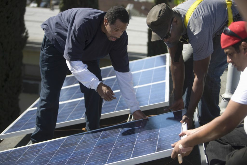 professional solar panels expert working on new construction